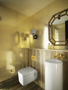 The decadent gold bathroom inside the Tierney Watson House, designed by Greg Natale.