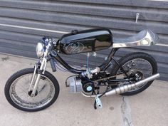"""My bro's custom moped. """"The baby maker"""". The 2 is for his twins."""