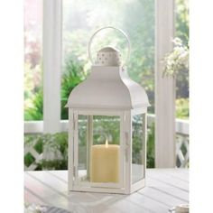 A pillar of style on the outside with the pillar candle of your choice on the inside! This large metal lantern features a soft white finish and four c...