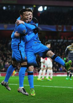 Lionel Messi celebrates with Neymar of after scoring a goal during the UEFA Champions League round of 16 first leg match between Arsenal and Barcelona on February 23, 2016 in London, United Kingdom.