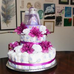 This DIY Purple and White Diaper Cake is super simple and a great way to give Moms-to-Be a pretty yet practical gift. Baby Shower Gifts To Make, Diy Baby Gifts, Baby Crafts, Diy Diaper Cake, General Crafts, Practical Gifts, Homemade Baby, Easy Diy, Simple Diy