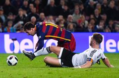 Lionel Messi of FC Barcelona is brought down by Shkodran Mustafi of Valencia CF during the Copa del Rey Semi Final first leg match between FC Barcelona and Valencia at Nou Camp on February 3, 2016 in Barcelona