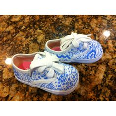 My niece Shevani hand painted the artwork on these shoes for my baby.