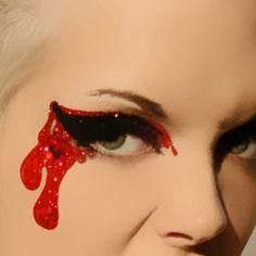 Glittering blood drops eye make-up - beautiful.