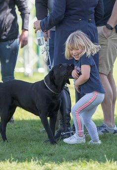The mischievous tot Mia Tindall could be seen squealing with delight when a dog came up to say hello