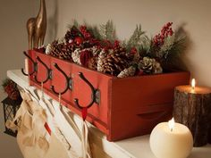 """Nifty idea for an old or new drawer. Doesn't need to be Christmas - could be a storage box on a bedroom shelf with hooks on it for """"stuff""""--perfect for hanging stockings where can't or don't want to put tacks or nails."""