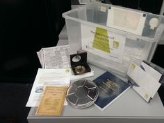 'The Adventures of the Girl Pat': Educational resource box. 6 penny school atlas and reproduction compass. Compass, Archive, Adventure, Education, Film, School, Box, Movie, Snare Drum