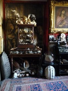 The Cabinet, or Museum in the Museum A tortoise shell and a brain coral along with many exotic shells, some collected by Dr Knox and Dr Longstaffe Gowan during their far flung childhoods, fossils, dried and preserved bird speicimens, skeletons, lapidary treasures and ethnographic curiosities. On the wall behind, the giant engraving made up of nine plates is The Mocking of Christ after Van Dyck.
