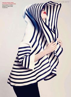 the peak of red lips against the graphic stripes makes for a fabulous fashion…