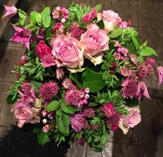 Pink bouquet including anenomes, roses, clematis, wax flower and astrantia