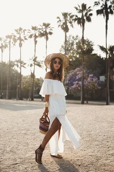 Lovely Pepa White Paros Off The Shoulder Maxi Dress With Side Split Teamed With Sigerson Morrison Thong T-Strap Sandal With Bold Ankle Buckle Closure And Low Stacked Heel And Straw Wide Brim Hat