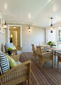Love this porch - especially the natural wood chairs and the lights