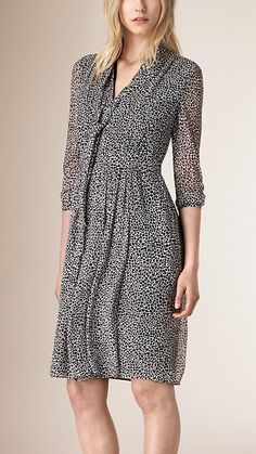 Burberry dress woven in Italian silk georgette crepon with an animal print. The soft, feminine silhouette is complemented by a gently ruched, fitted waist and a tie detail at the neckline. Discover the women's dress collection at Burberry.com