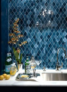 Navy arabesque backsplash, design by Ashley Whittaker via: desire to inspire. Totally love this color!!!!