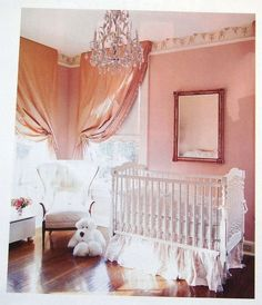 Traditional home nursery. I could just eat up this pink. It's lovely. Interesting way to tie back the curtains. Good idea. I might choose a different chandelier and I would use crown moulding instead of wallpaper, but I just love everything else.
