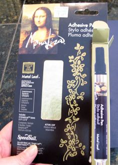 Gold leaf almost anything with precision with Mona Lisa Gold Leaf Adhesive Pen and Sheets of Gold Leaf. Tutorial for how to gold leaf words or wall art.