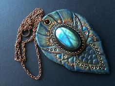 Hand tooled leather fantasy pendant with amazing shiny labradorite cabochon and copper chain - Artisan jewelry