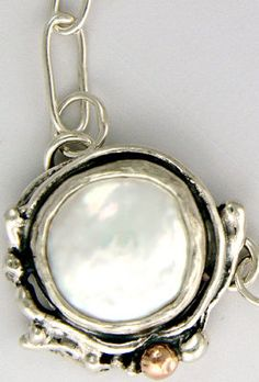Coin Pearl Pendant by Sherry Tinsman at Quirks of Art. Inspired by nature, her home along the Delaware River, and her English heritage her pieces feature distinctive patterns and shapes which characterize her work. Pieces are hand fabricated using sterling silver, 14k yellow, or rose gold accents. To add a whimsical elegance, I set some of my pieces with semi-precious stones or pearls. All jewelry 100% handmade