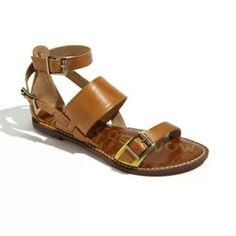 SAM EDELMAN GENEVA SANDAL Named by ELLE magazine as one of the must have sandals! A trio of buckles secure the mixed-width straps that distinguish a flat leather sandal subtly highlighted at the toe strap with a contrast inset. Adjustable straps with buckle closures. 100% Leather upper/synthetic lining and sole. Extremely comfortable.  Amazing condition. NOTE: right back has a tiny mark please look at pic, barely noticeable. Sam Edelman Shoes