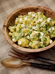 Make the most of seasonal new potatoes with this classic side dish recipe with spring onions, hard boiled eggs, gherkins and fresh herbs.