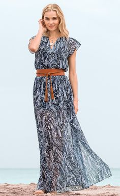 Get in touch with your inner free spirit with this WHBM flowy maxi dress in a whimsical feather print. Reach for our navy espadrilles to complement the boho-chic woven design.   White House Black Market