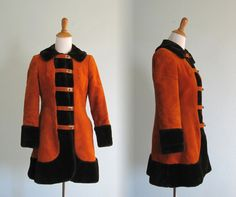 Awesome 60s hippie chic coat in pumpkin orange velvet. The coat is trimmed black fake fur and finished with unique gold tone clasps down the