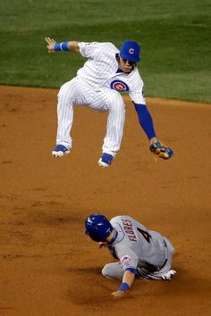 Javier Baez, CHC/Wilmer Flores, NYM/// Game 4, NLCS , Oct 21, 2015   (jon durr/getty images)
