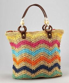 Before heading off to the beach, don& forget this wonderfully woven tote! Spacious enough to fit a favorite book and a towel for lounging, this braided bag shows off functional style with a vibrant zig-zag pattern that is sure to impress. Chevron Crochet, Crochet Tote, Crochet Handbags, Crochet Purses, Crochet Patterns, Bag Patterns, Handmade Handbags, Handmade Bags, Lidia Crochet Tricot