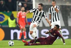 Miralem Pjanic of Juventus and Paulinho of Barcelona battle for possession during the UEFA Champions League group D match between Juventus and FC Barcelona at Allianz Stadium on November 22, 2017 in Turin, Italy.