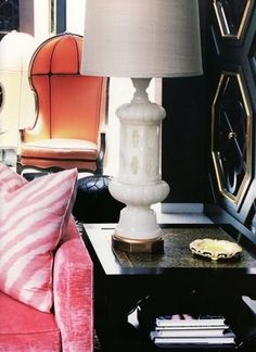 pastel furniture, black and mirrored walls, carved vintage lamp... perhaps for my Parisian pied-à-terre.