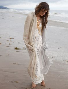 This is very Jasmine. White dress. Cardigan. Layers on the beach.