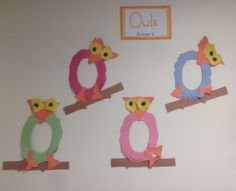 O is for owl. Older toddler children practiced their fine motor skills by cutting out owls and gluing the pieces together.