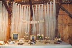 Wedding Ideas: add rustic and romantic flair with tulle fabric as a dessert table backdrop.