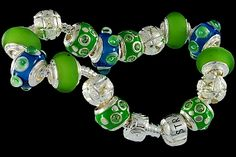 silver plated items: bracelet with snap closure, enamel beads with cubic zirconia, balls, lock. Seven glass beads with 925 silver core.