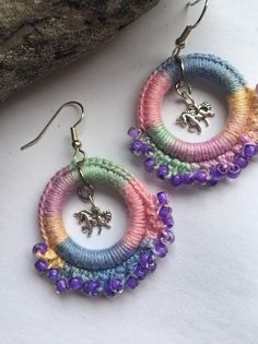 Unicorn Earrings are created with variegated pastel cotton crochet thread, purple glass seed beads, and a tiny silver unicorn charm. Boho Crochet, Freeform Crochet, Cotton Crochet, Thread Crochet, Crochet Fashion, Crochet Flowers, Tatting Patterns, Crochet Patterns, Crochet Earrings Pattern