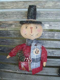 Primitive stump style snowman doll handmade ooak great for your winter decor.. $56.00, via Etsy.