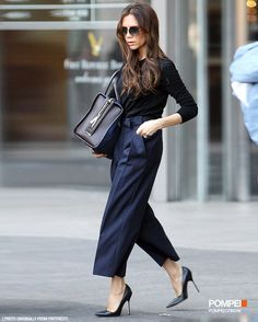 Victoria Beckham is a trendsetter. She put on a 3/4 length navy blue pants, that's the key point of her style, match with long  sleeves black t-shirt and high heels, absolutely trendy.  Find out more skirts↓↓↓ http://www.pompei.com.hk/products/WOMEN/Clothing/PANTS?outfit=N  #Pompei #Pants #VictoriaBeckham #fashion