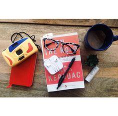 How to #pack for an afternoon at the #coffeeshop - a good #read, your trusty #headphones, and a small #journal to capture all your #inspiration. #traveltuesday #betransported