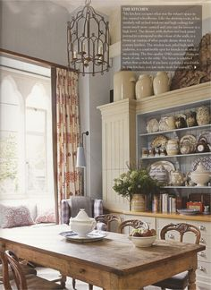 A little too foo-foo for me, but a good idea to display crockery. Note the blue interior of the hutch.