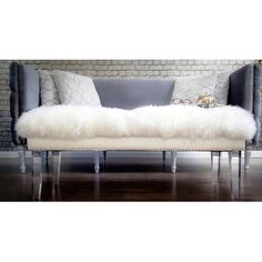 Features:  -Real sheepskin top.  -High quality clear lucite legs.  -Handmade by skilled furniture craftsman.  -Hand-applied silver nail head trim around leather border.  -Seat features a solid wood ki