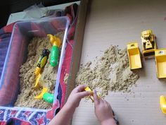I hadn't set out sand in the sensory table until this past week and boy did the children love it! Setting out Tools for Play Along with the sand, I put out a large shallow box, some shovels, and Sand And Water Table, Sand Table, Classroom Activities, Preschool Ideas, Classroom Ideas, Community Helpers Preschool, Train Table, Sandbox, Center Ideas