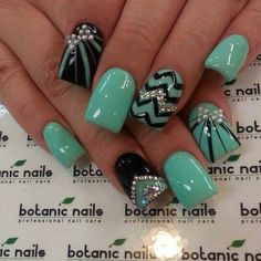 Adorable turqouise chevron nails! Just maybe without the studs so it's not girly for me. :)