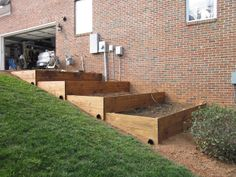 Check out how these folks are putting in raised beds so they can garden on a sloped yard. A sloped yard can present a bit of a challenge if you are considering putting in a backyard garden.