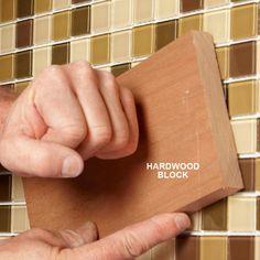 Level Mosaic Tile With a Block - 17 Modern Tile Installation Tips: http://www.familyhandyman.com/tiling/tile-installation/modern-tile-installation-tips