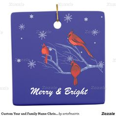 Merry & Bright. Happiest Holidays. Snow Scene with Red Cardinals Design Customizable Ceramic Christmas Ornaments. Enter the year and name of your family in the space provided. Matching cards, postage stamps and other products available in the Christmas & New Year Category of the artofmairin store at zazzle.com