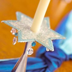 It was intended for Hanukkah but I think it would be fun for other times! A cardboard star cutout is not only beautiful, but acts as a wax catcher. Cover the star in decorative paper and embellish the edges with beads. Jewish Hanukkah, Hanukkah Crafts, Jewish Crafts, Hanukkah Decorations, Christmas Hanukkah, Happy Hanukkah, Hannukah, Paper Decorations, Holiday Crafts