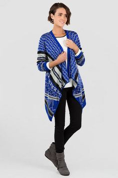 "Tribal printed sweaters are back this fall!  The Cabrillo Tribal Sweater Wrap features a blue, grey & black tribal print that looks great on this draping wrap.  Style over a simple tee with a pair of jeans & boots for a cute fall look.<br /> <br /> - 36"" length from shoulder to hem<br /> - 40"" chest<br /> - measured from a size small<br /> <br /> - 100% Acrylic<br /> - Machine Wash<br /> - Made in U.S.A."