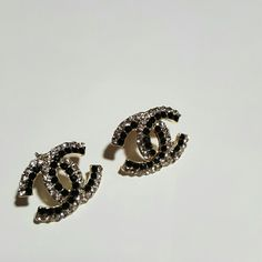 CHANEL Earrings Gold backings with black and crystal front. CHANEL earrings. CHANEL Jewelry Earrings