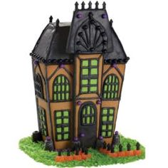 Eerie Entrance Halloween Gingerbread House by Wilton pre-baked cookie set. Not so scary after all! Halloween Gingerbread House, Casa Halloween, Halloween Haunted Houses, Christmas Gingerbread, Halloween Cakes, Holidays Halloween, Halloween Treats, Halloween Party, Halloween Decorations