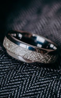 Men's Wedding Band with synthetic Meteorite Inlay. This mens ring shines with its high polished finish.